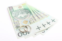 Wedding rings and money on a white background Stock Image