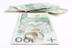 Wedding rings and money on a white background Stock Photography