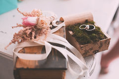 Wedding rings on moss on table Royalty Free Stock Photography