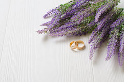 Wedding rings near bouquet Stock Photography