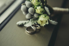 Wedding rings near boutonniere Stock Images