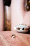 Wedding rings near jewelry box Royalty Free Stock Photography