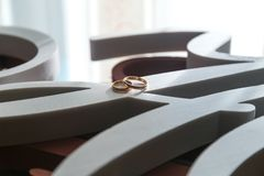 Wedding rings near the window waiting for the bride royalty free stock photos