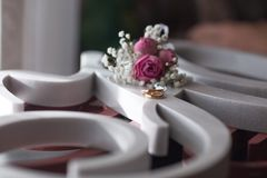 Wedding rings near windowon the plastic signs with flowers royalty free stock image