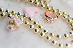 Wedding rings and necklace Stock Photography