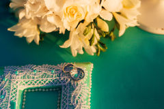 Wedding rings of a newly-married couple on a cushion for rings. Royalty Free Stock Photography