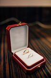 Wedding rings of the newlyweds in a box. Engagement gold rings Royalty Free Stock Photography