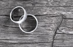 Wedding rings on old wood. Wedding rings  on old wood, selective focus royalty free stock image