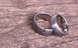 Wedding rings on old wood. Wedding rings  on old wood, selective focus stock image