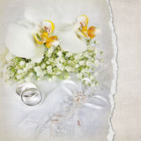 Wedding rings with orchids stock illustration