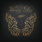 Wedding rings and ornamental wings Stock Image