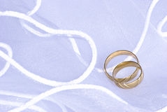 Wedding rings over veil royalty free stock photo