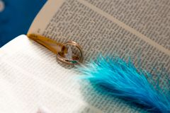 Wedding rings on a bible. Wedding rings in the pages of the Holy Bible. Church of Nazarene Royalty Free Stock Photos