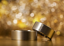 Wedding Rings. Pair of wedding rings, closeup, sparkling bokeh background Stock Photo