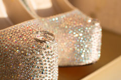 Wedding rings. A pair of wedding rings on wedding shoes Stock Photography