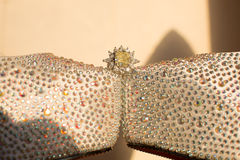 Wedding rings. A pair of wedding rings on wedding shoes Stock Photos