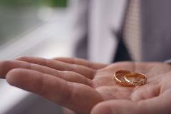 Wedding rings on the palm of the groom, marriage Stock Photo