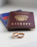 Wedding rings and the passport of Russia. Passports of Russia newly married and two wedding rings Royalty Free Stock Photo