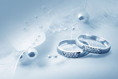 Wedding rings and pearl decor Royalty Free Stock Image
