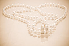 Wedding rings and pearls Stock Image
