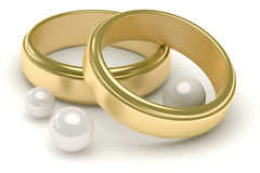Wedding rings and pearls. Pair of gold wedding rings and pearls Stock Photo