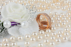 Wedding rings among the pearls with flower Stock Image