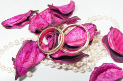 Wedding Rings. In pearls and rose petals Stock Photo