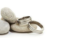 Wedding rings on pebbles isolated Royalty Free Stock Photo