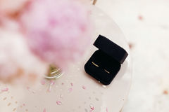 Wedding rings with peonies background Royalty Free Stock Photo