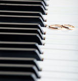 Wedding rings on a piano Royalty Free Stock Images