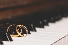 Wedding rings piano key Royalty Free Stock Photos
