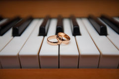 Wedding rings. On piano keys Stock Images
