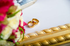 Wedding rings on the piano Stock Photography
