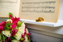 Wedding rings on the piano Royalty Free Stock Photography