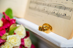 Wedding rings on the piano Royalty Free Stock Photo