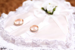 Wedding rings on a pillow ceremonial Royalty Free Stock Photos