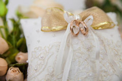Wedding rings on a pillow ceremonial Stock Images