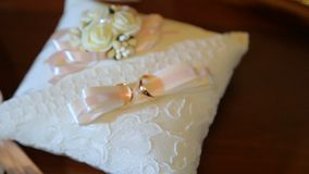 Wedding rings on the pillow for the wedding ceremony. Wedding rings on the pillow stock video footage