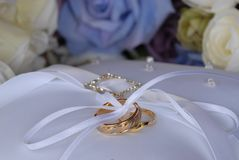 Wedding Rings on pillow Stock Images