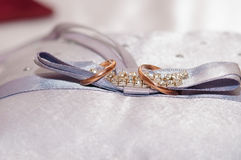 The wedding rings on a pillow Stock Image
