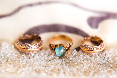 Wedding rings on the pincushion with beads Royalty Free Stock Image