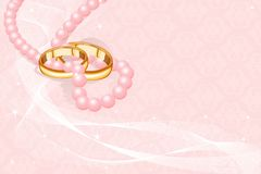 Wedding rings on pink Stock Images