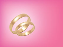 Wedding rings on pink background Stock Photo