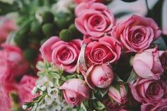 Wedding rings on pink flowers Royalty Free Stock Image
