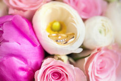 Wedding rings in pink flowers Stock Photography