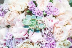 Wedding rings on flowers Royalty Free Stock Photo