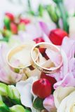 Wedding rings on flowers Royalty Free Stock Image