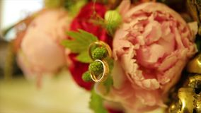 Wedding rings and pink rose bouquet. Wedding rings on a wedding bouquet. Wedding rings on a bouquet of roses. Wedding rings and pink rose bouquet. Wedding rings stock footage