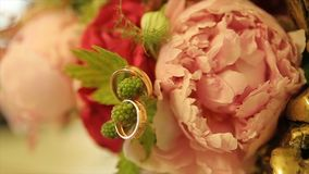 Wedding rings and pink rose bouquet. Wedding rings on a wedding bouquet. Wedding rings on a bouquet of roses royalty free stock photos