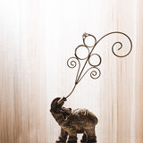 Wedding rings placed on an elephant figurine Royalty Free Stock Photos